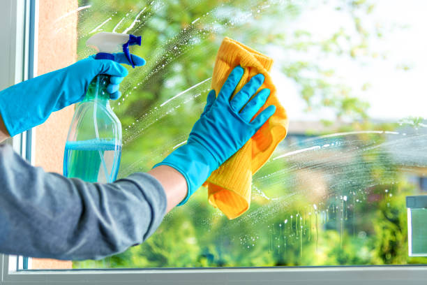Cleaning window pane with detergent, spring cleaning concept