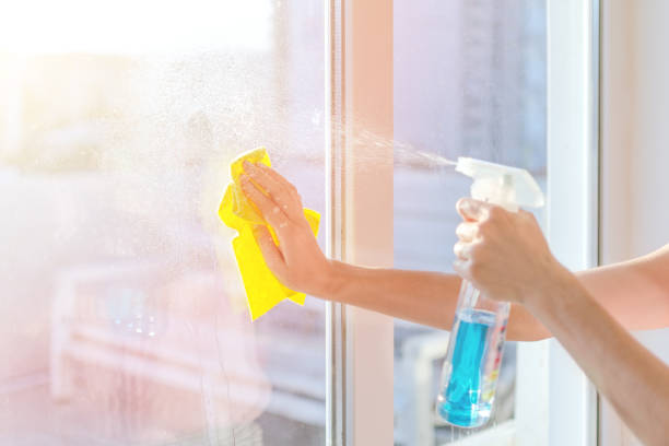 hands-with-napkin-cleaning-window-washing-the-glass-on-the-windows-picture-id1136340520